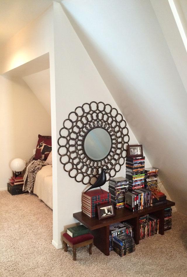slanted hallway decor+sitting area