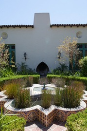spanish style mission home and courtyard