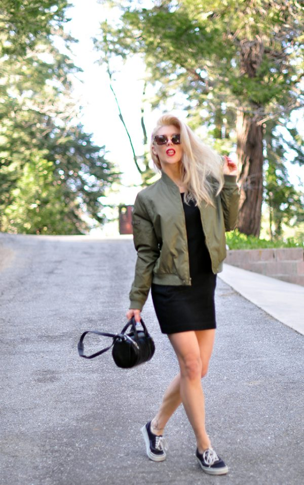 little black dress with sneakers and a bomber jacket