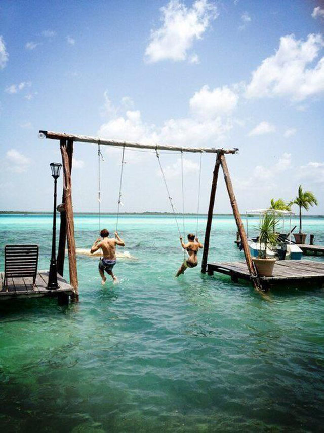 swingset over the water