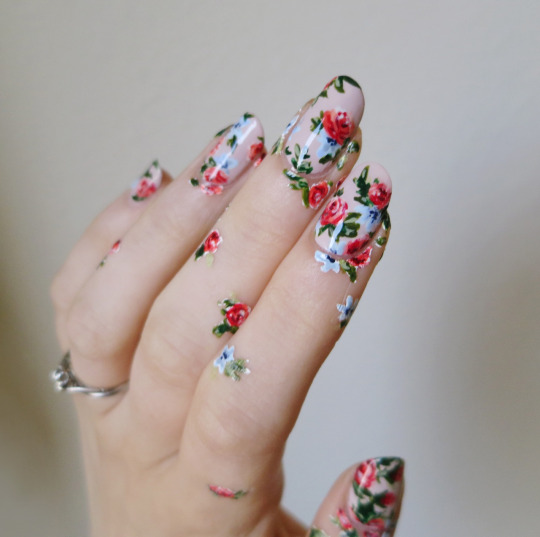 floral nails + floral hand tattoos