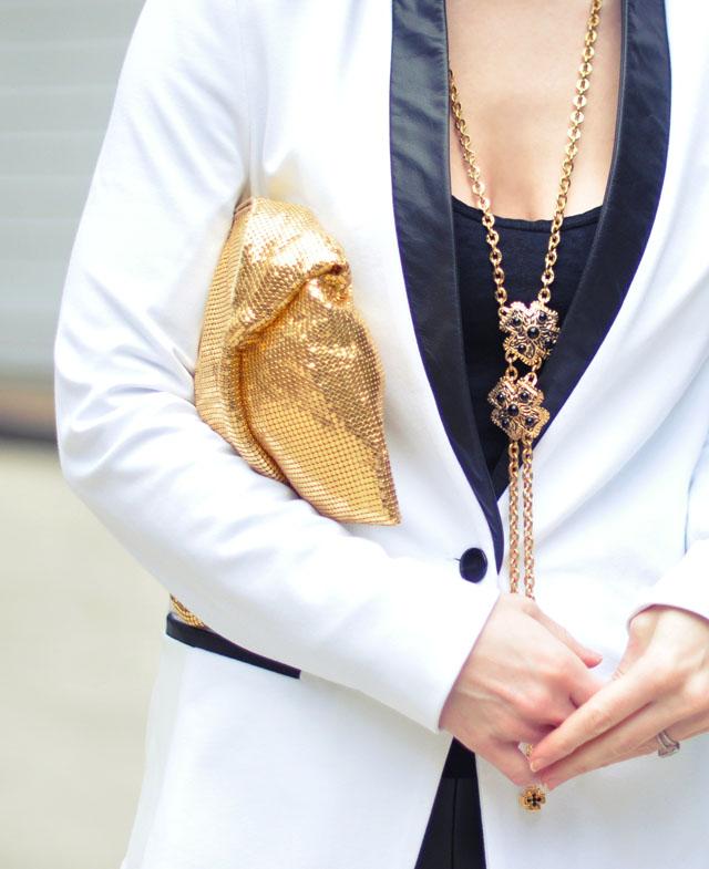 white blazer-leather lapels-gold clutch-necklace