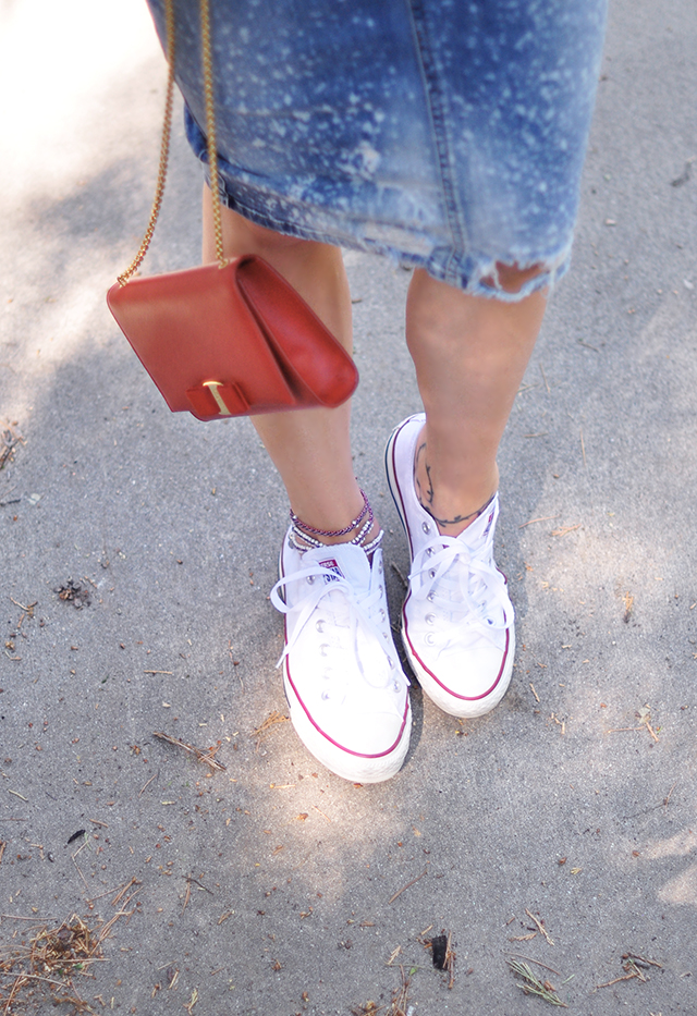 white chuck taylors_anklet_ferragamo miss vara red bag_deconstructed denim skirt